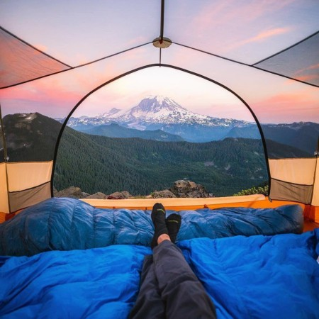 This transparent tent with a sunset view of Mount Rainier