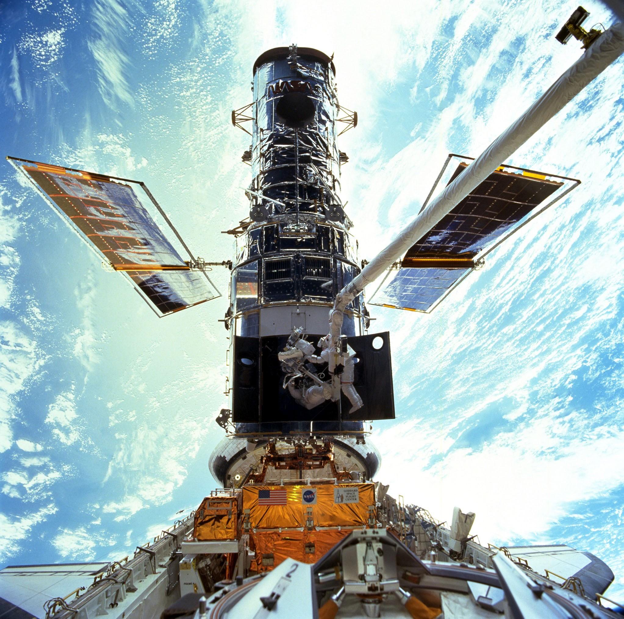 Steven Smith & John Grunsfeld servicing the Hubble Space Telescope