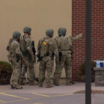 A suspect has been arrested and hostages released after an eight-hour standoff at a Minnesota bank, police say