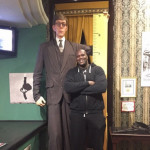 Shaquille O'Neal standing next to a life-size replica of the tallest man in history