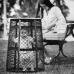A mom uses a trash can to contain her baby while she crochets in the park, 1969