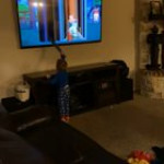 Is he trying to get inside the TV by breaking it?