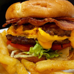 Homemade double smash burger with extra cheese and extra bacon