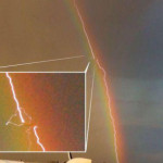 Plane struck by lightning over a rainbow