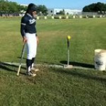 Girl With A Bat Hits A Ball