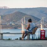 Guy looking at the almost completed Pelješac bridge, Croatia