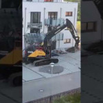 Angry builder destroys empty flats of a new building with an excavator, because he was not paid after finishing them