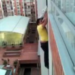 Dog hanging off a balcony