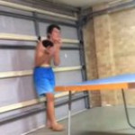 Kid throws ping pong paddle at his brother