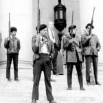 The Black Panther Party on the steps of the Washington State Capitol in Olympia, protesting gun control, 1969