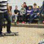 Teacher shows off his skateboarding skills to his students