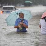 At least 25 killed, 200,000 displaced by evacuations as torrential rain floods China's Henan province