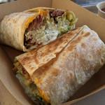 California-style burrito stuffed with smoked barbacoa, fries, guac, cheddar, and jalapeno crema