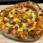 I made a pizza with chorizo, jalapeño and pineapple