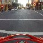 Motorcyclist gets hit by a car running a red light, flips in the air, and lands on his feet