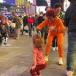Encouraging a little girl to twerk in the middle of a crowd