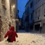 Sea foam fills the streets of Spain after a storm hits the country