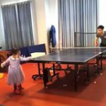Little girl playing table tennis