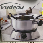 """The lovely piece of """"meat"""" shown on the box of this fondue set"""