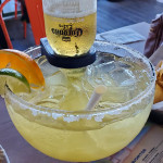 Coronarita Physics: what forces keep the beer from draining to margarita level?