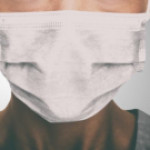 Breast cancer patient punched and insulted by activists protesting clinic's mask policy