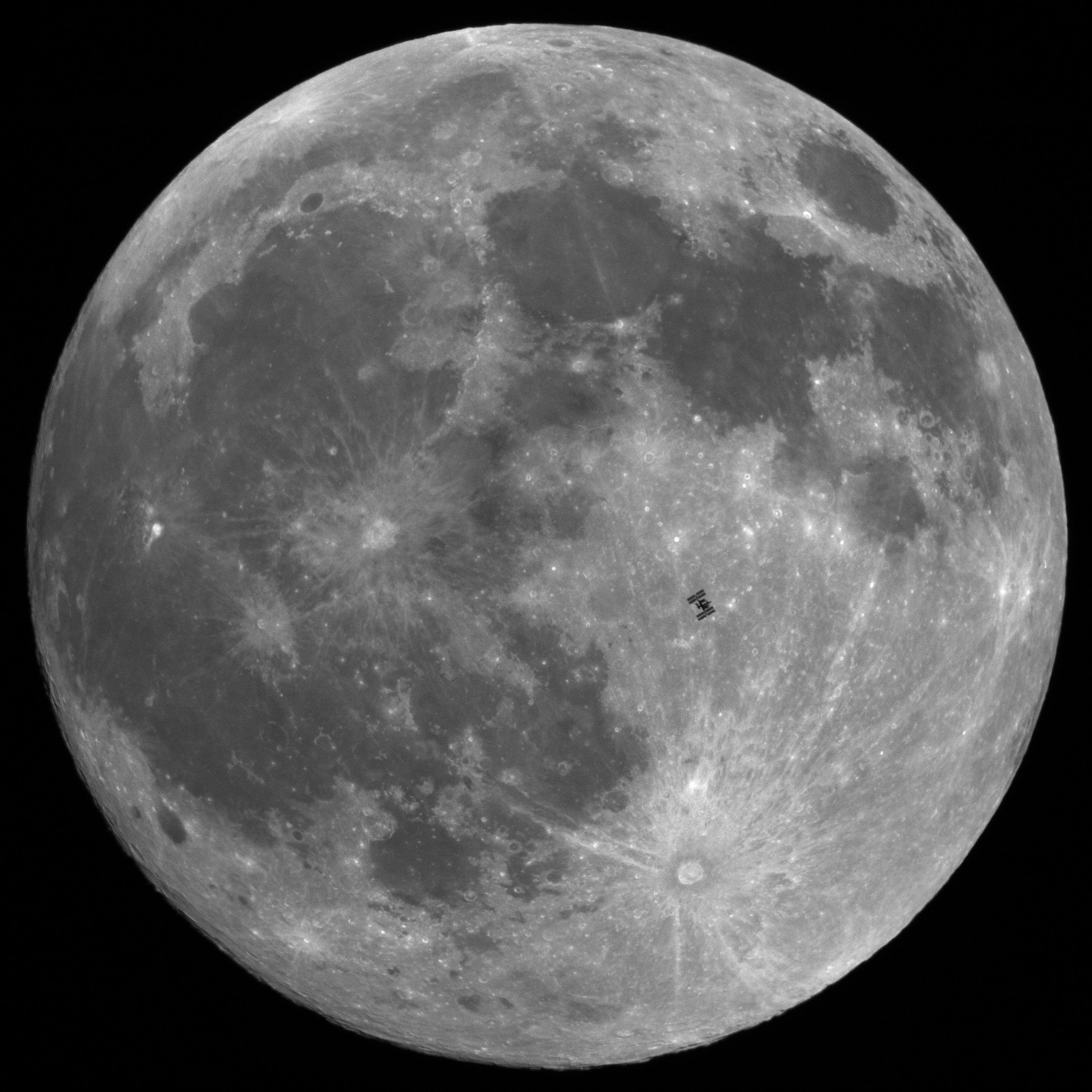 The International Space Station in front of the full moon
