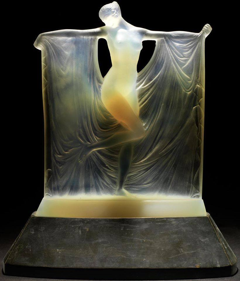 Opalescent Glass Statuette made in 1925 by Rene Lalique. It is 8¾ inches tall