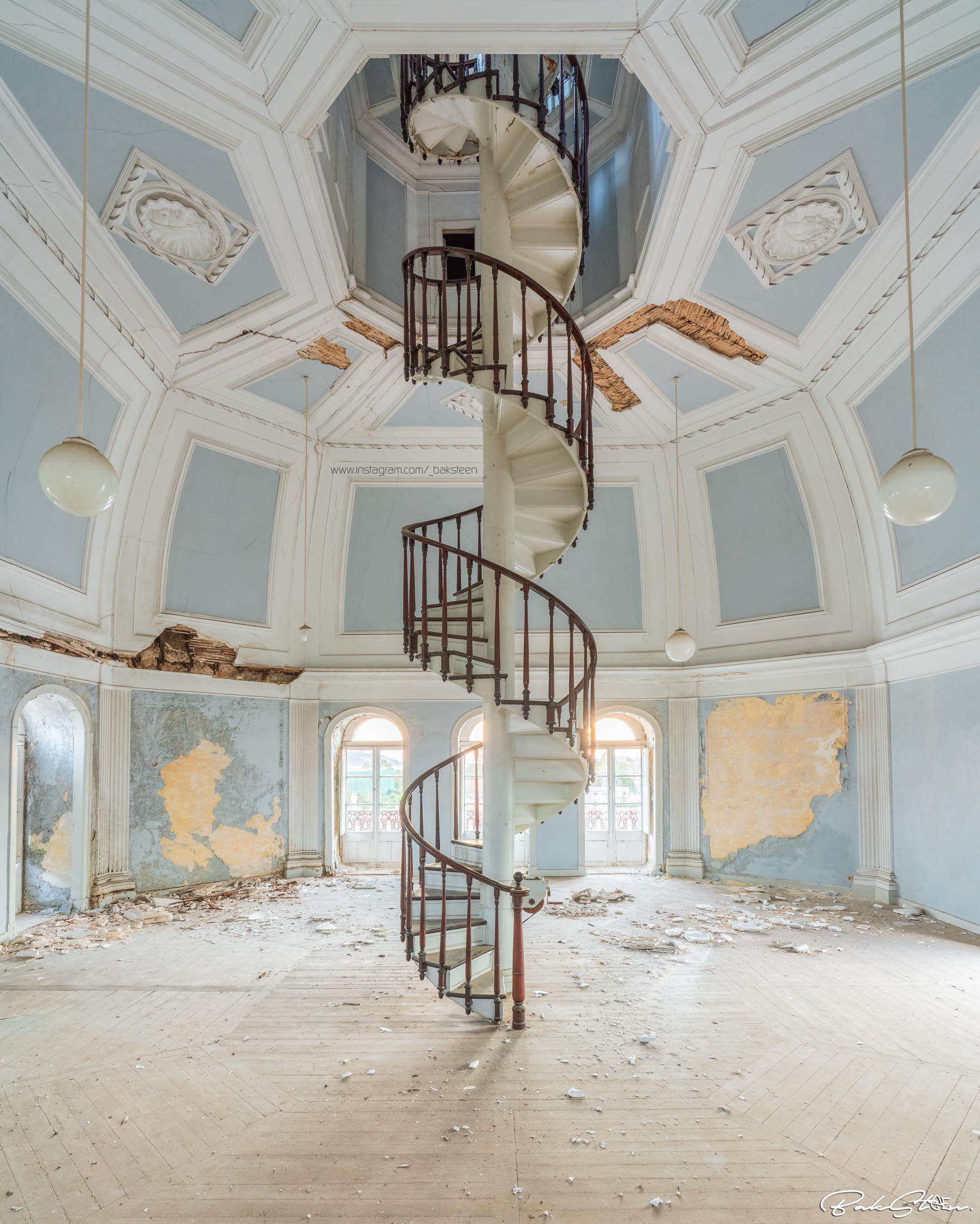 Spiral staircase to the attic of an abandoned school