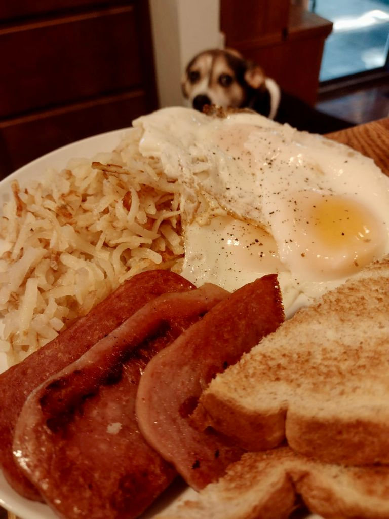 Spam, hash browns, eggs, and toast