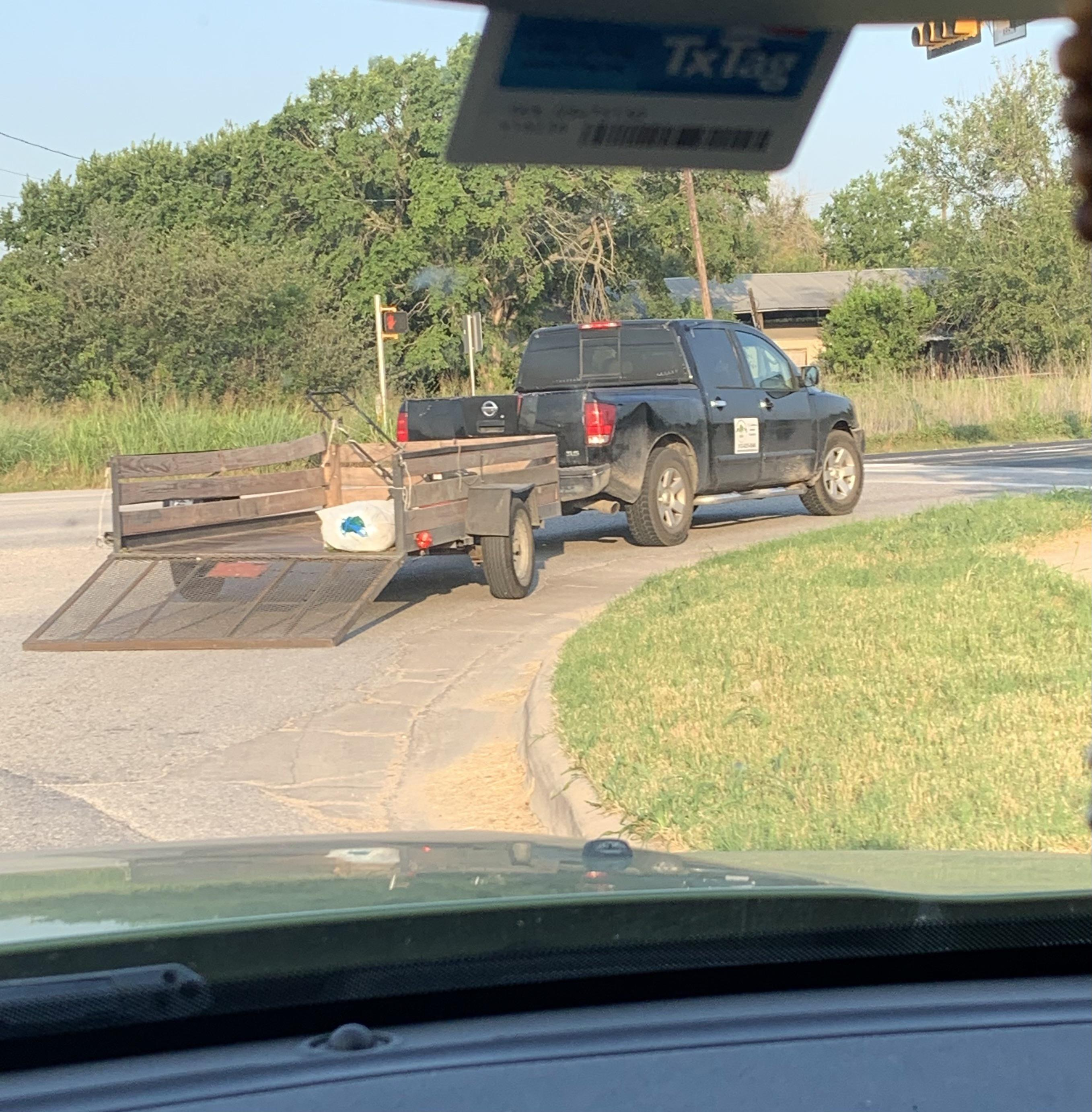 Followed this idiot with his trailer gate dragging for miles