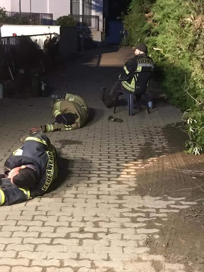German firefighters resting in the middle of the street after the flood in Germany. Respect for all the heroes doing theire best