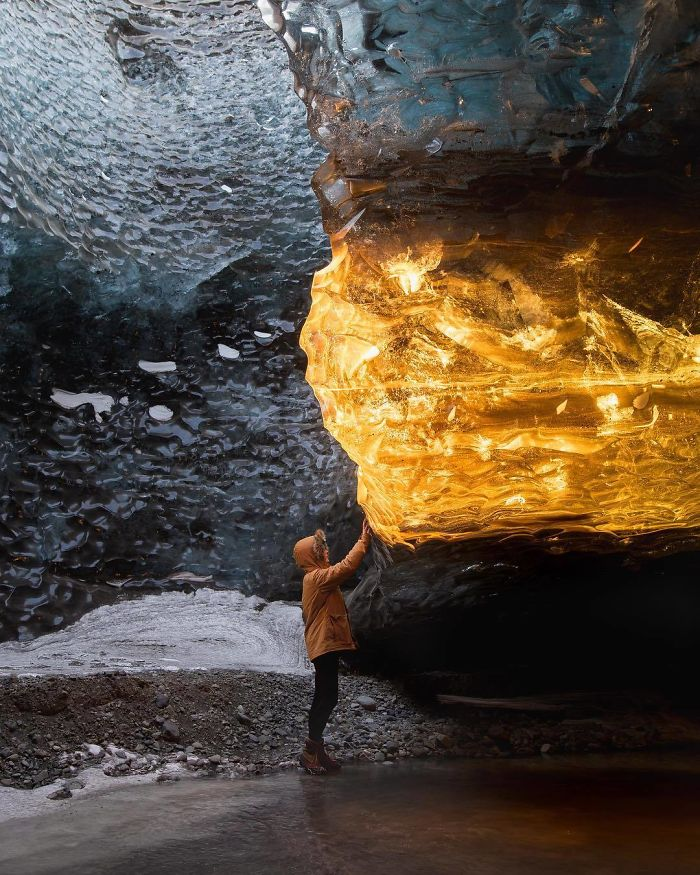 The golden rays of the sunset entered the cave at just the right angle to light up this section of ice, making it look like amber