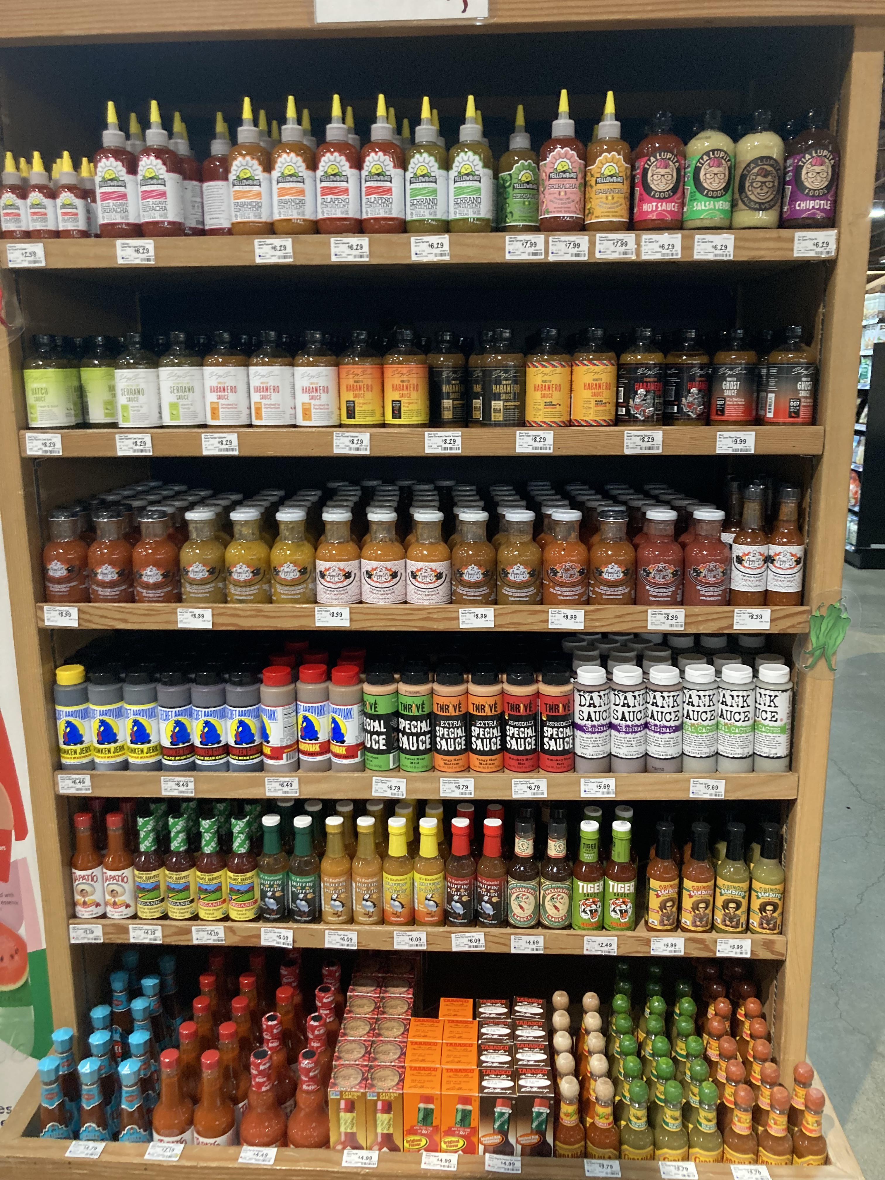 This hot sauce display at a grocery store