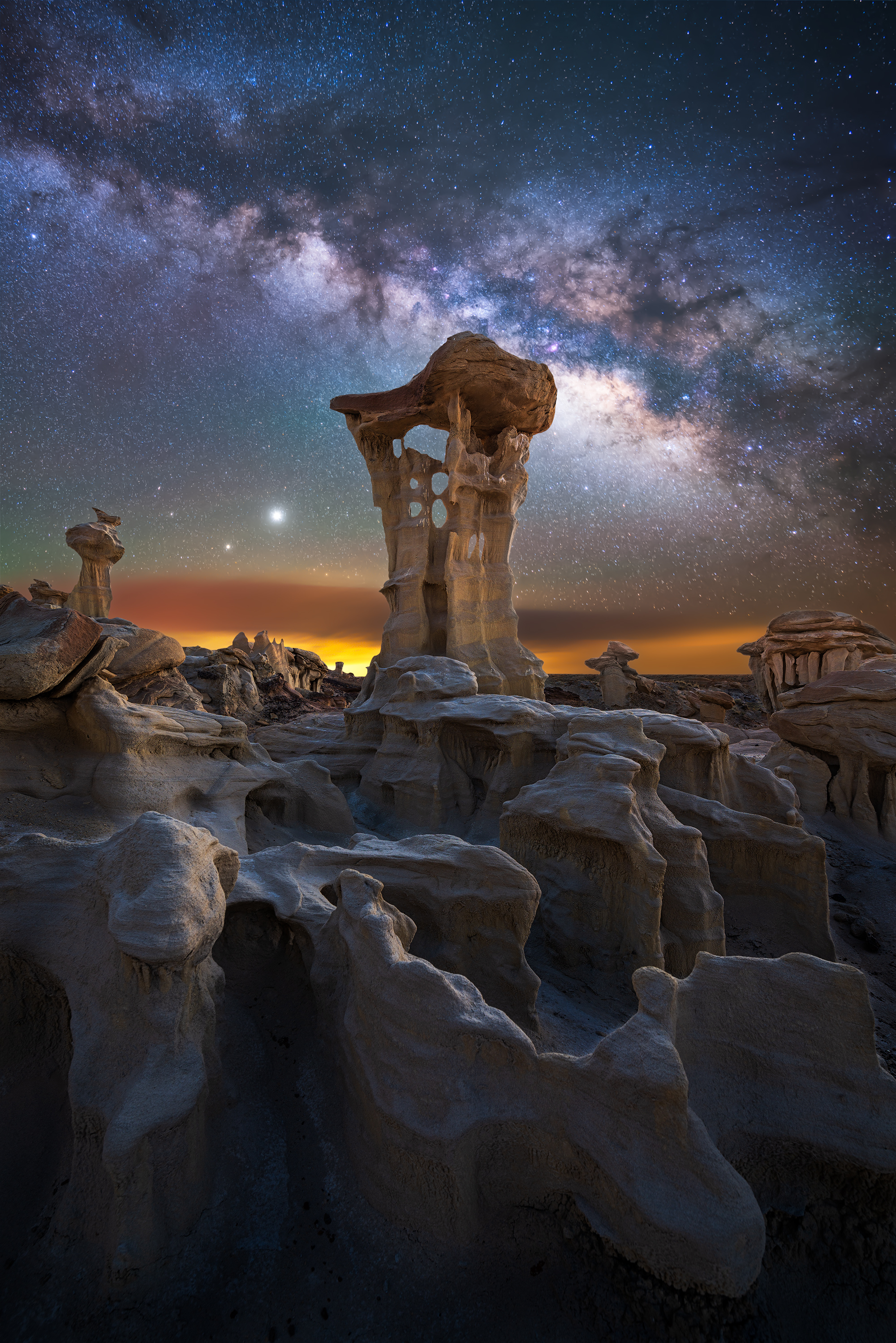 Milky Way, Jupiter and Saturn captured over otherworldly rock formations located in a remote part of New Mexico