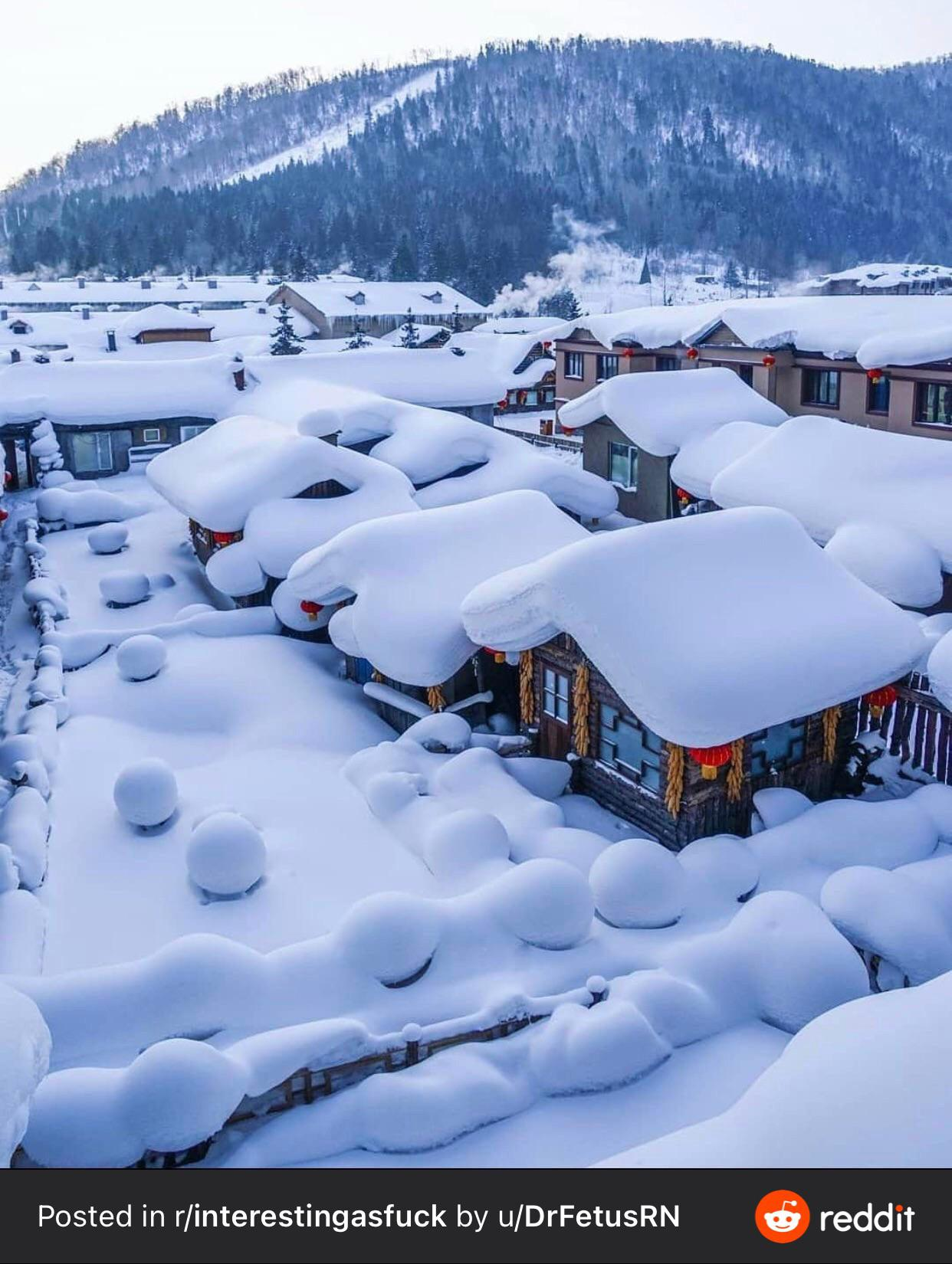 The way the snowfall covers this town